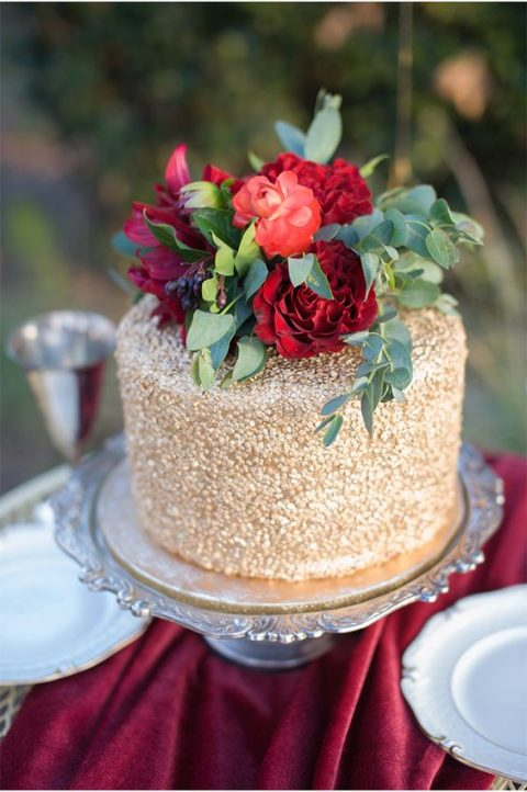 20 elegant red and gold wedding ideas happywedd a gold wedding cake topped with red blooms and greenery junglespirit Image collections