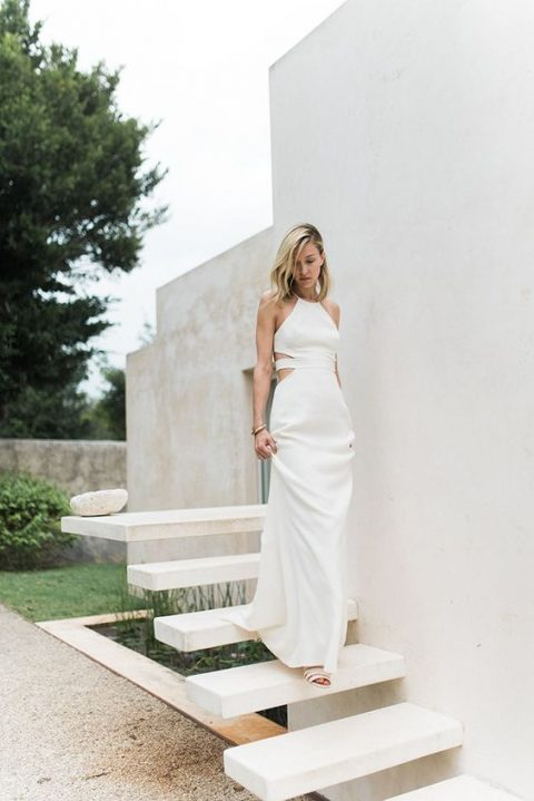 a halter neckline wedding gown with side cutouts
