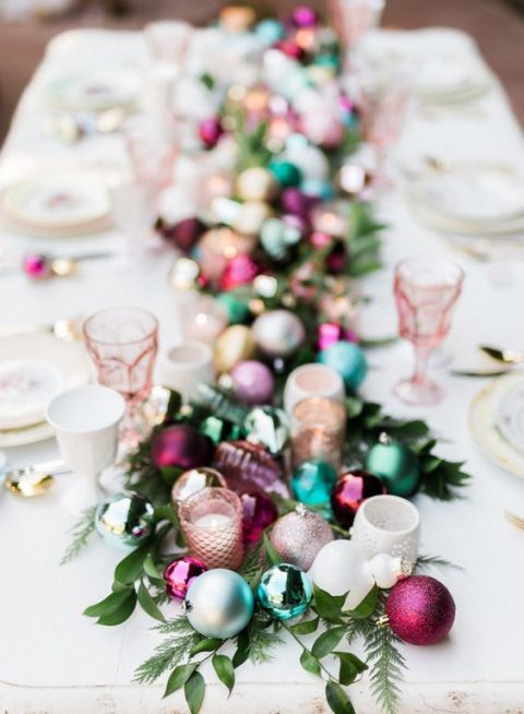 a holiday table runner made of Christmas tree ornaments in bold colors
