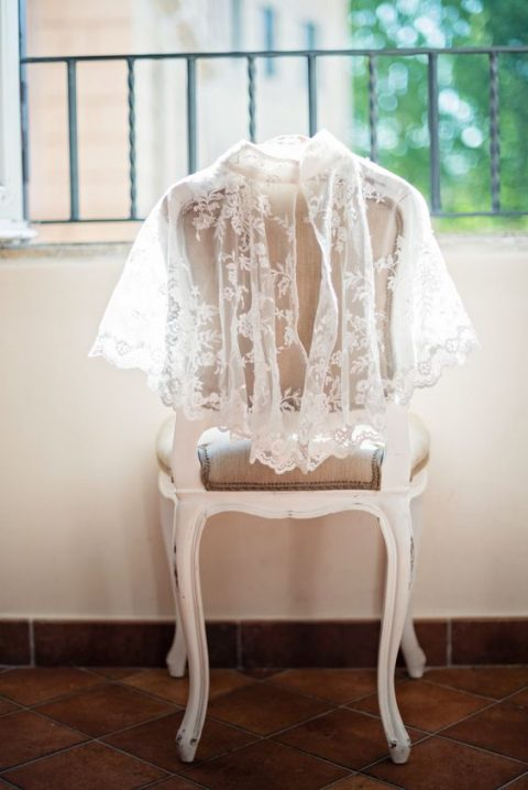 a lace capelet for a church ceremony
