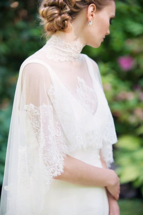 a lace capelet with a lace turtleneck collar