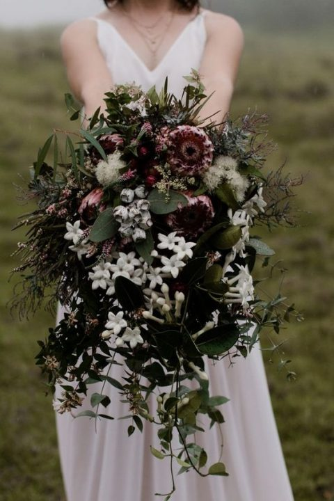 a lush and textural moody wedding bouquet with white_ pink and green touches