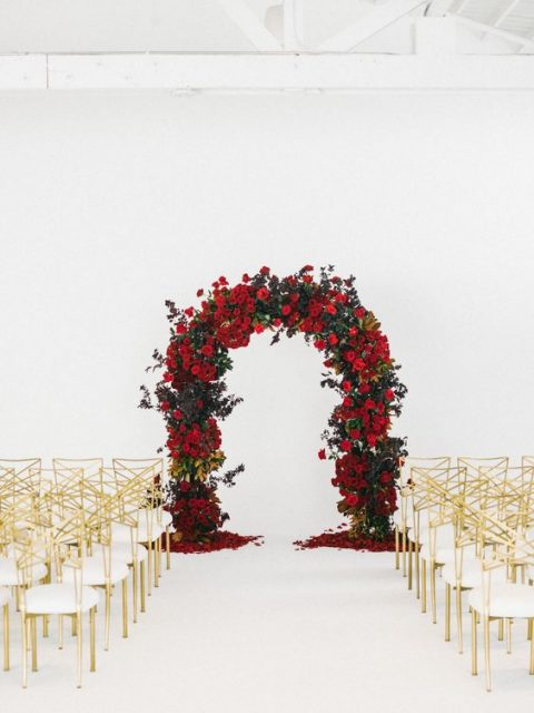 20 elegant red and gold wedding ideas happywedd a lush red rose arch and gold and white chairs for the ceremony space junglespirit Gallery