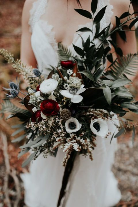a moody bridal bouquet with thistles_ white and red blooms and textural greenery