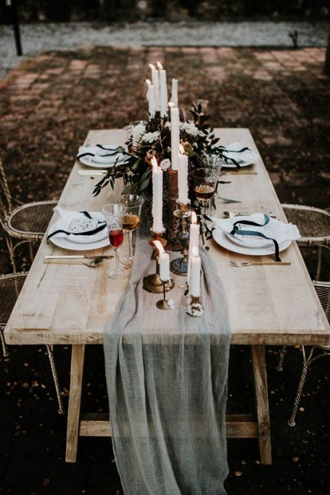 a moody winter tablescape with an ethereal runner_ dark florals and black ribbons