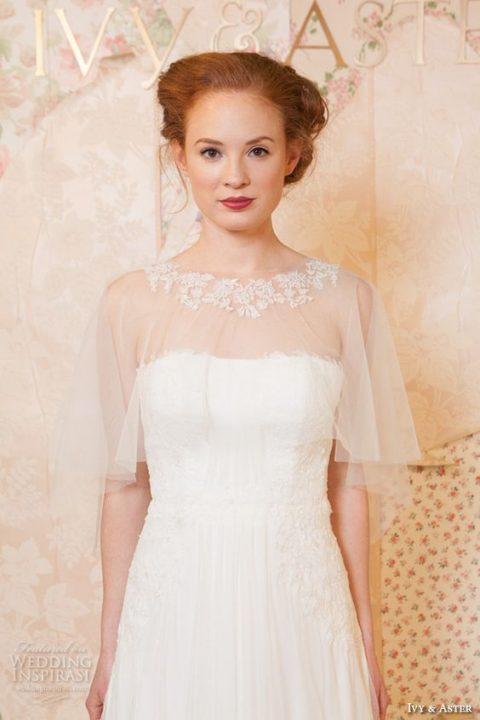 a sheer capelet with a lace neckline