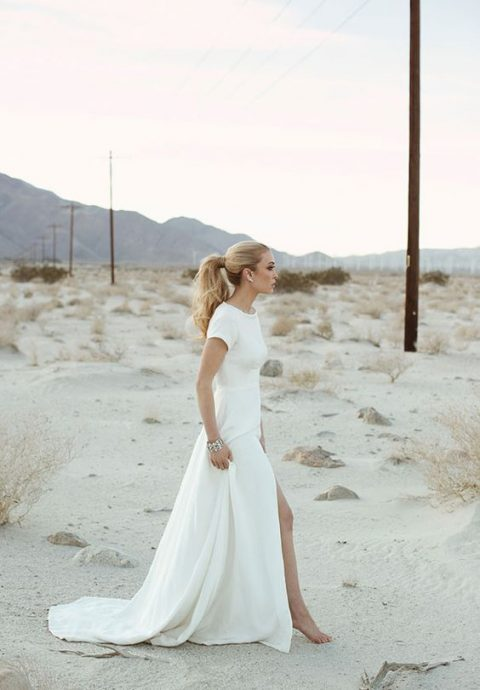 a short sleeve bateau neckline wedding dress with a front slit