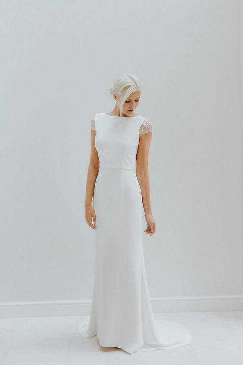 a simple wedding dress with cap sleeves embellished with pearls