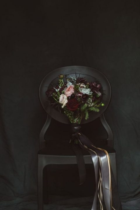 a very dark bridal bouquet with black ribbons and a touch of blush