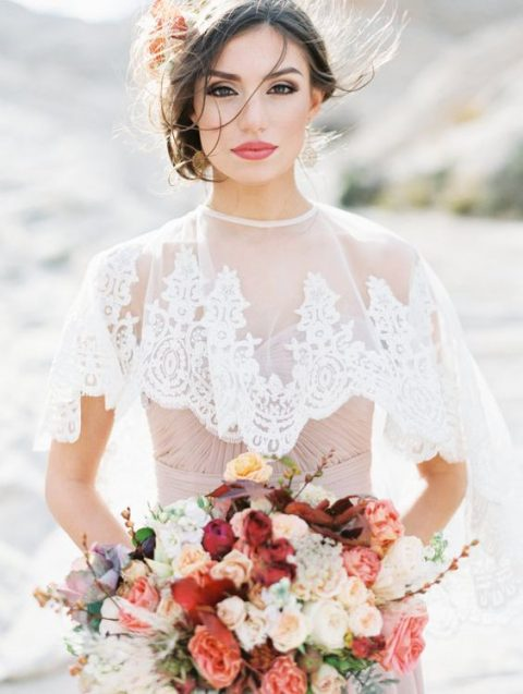 a white lace capelet with a lined collar