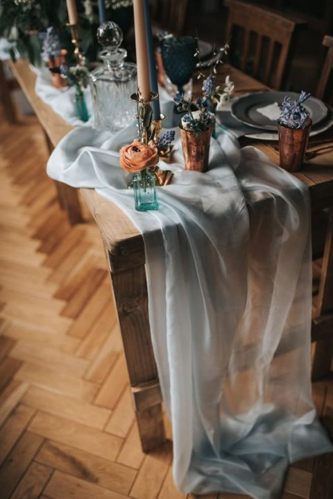 an ethereal and flowy light blue table runner