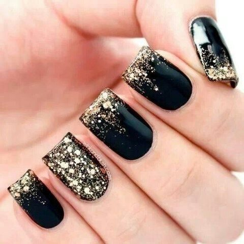 black nails with gold glitter touches look chic
