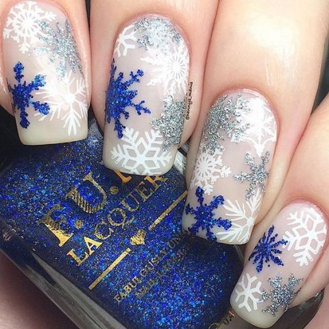blie and silver glitter and white snowflake nail art