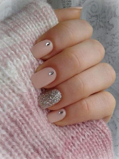 blush nails with rhinestones and a silver accent nail