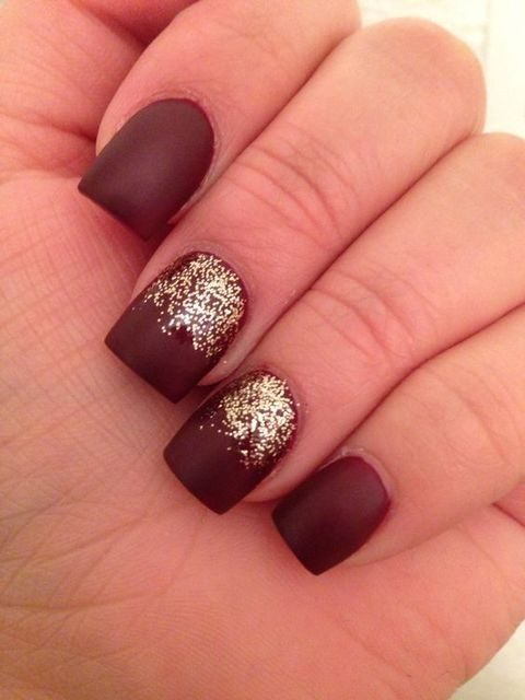 burgundy and gold glitter on two nails