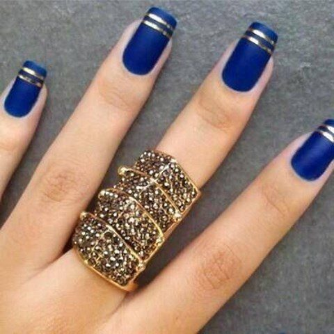 cobalt blue and gold stripe nails for a bold look