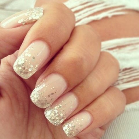 glam blush nails with a touch of glitter