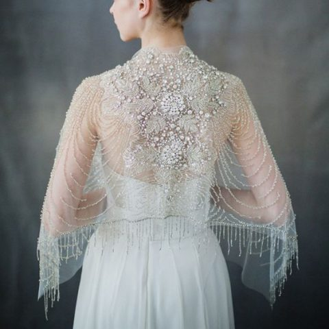 heavily embellished bridal capelet with pearls, rhinestones and fringe