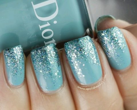 icy blue nails with glitter that reminds of snowflakes