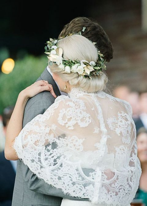 lace wedding capelet with a row of pearl buttons
