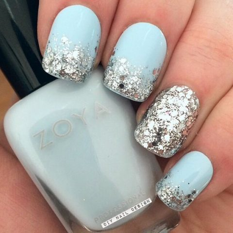 light blue nails with a touch of silver glitter