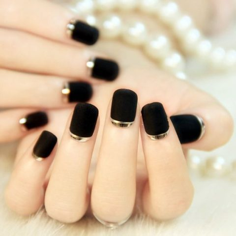 matte black nails with a touch of silver for a chic look