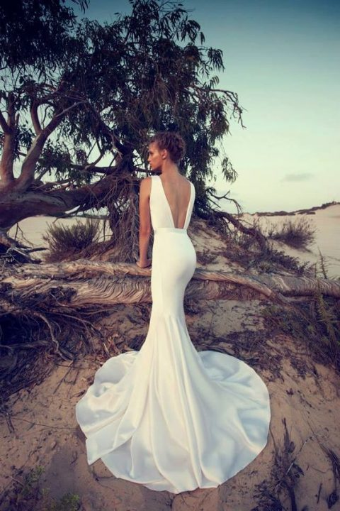 modern wedding gown with a cutout back and a a mermaid silhouette