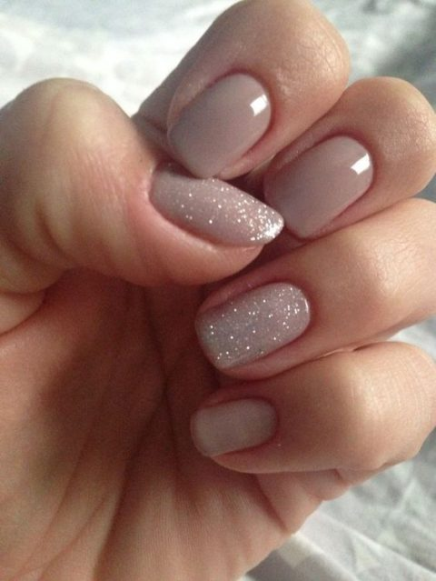 nude nails with a sparkly touch