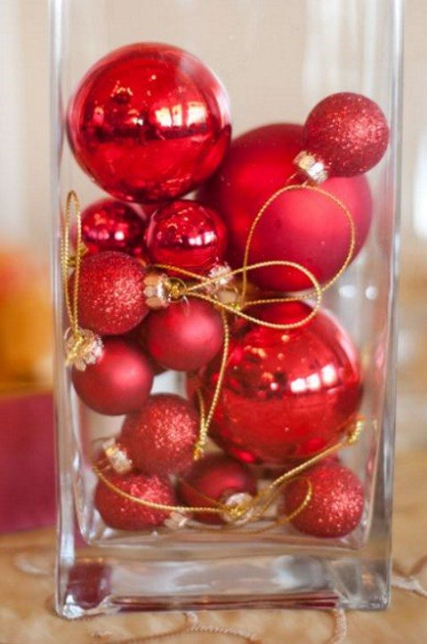 red and red glitter ornaments on gold threads as wedding favors or centerpieces