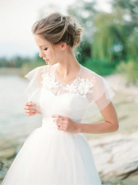 sheer wedding capelet with lace appliques on the neckline