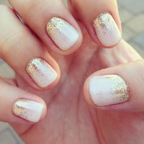 short white nails with gold glitter