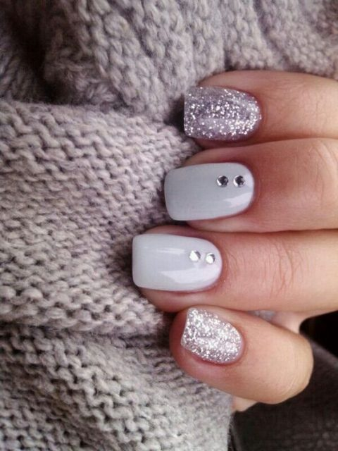 silver glitter and white nails with rhinestones for a stylish glitter touch