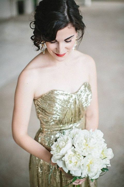 strapless gold sequin wedding gown and a red lip