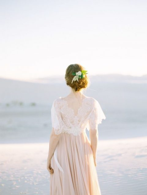 white lace capelet with a back cutout
