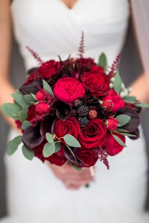 a bold bouquet with dark plum callas_ red roses_ berries and leaves