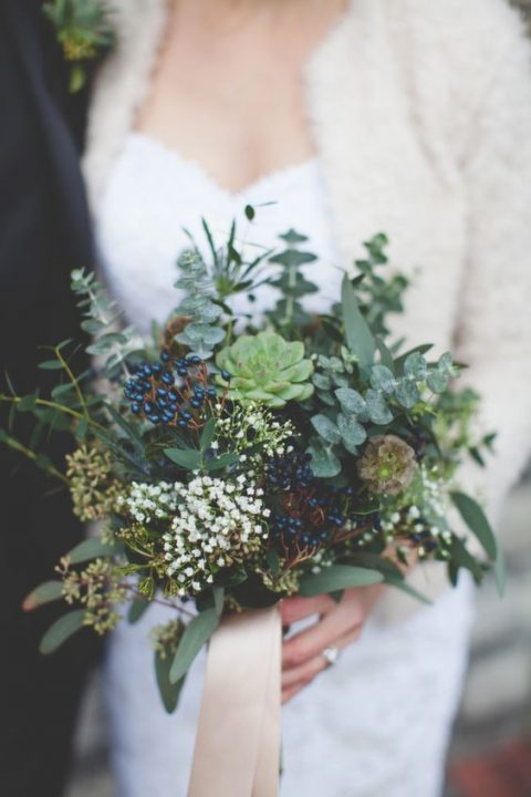 a bouquet of eucalyptus_ succulents and privet berries with blush ribbons