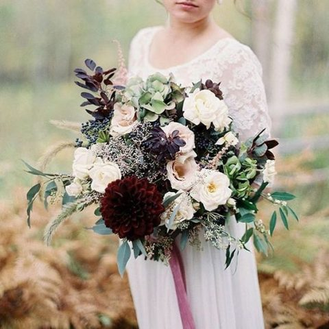a chic bouquet with dark foliage and blooms_ green hydrangeas and dark dahlias