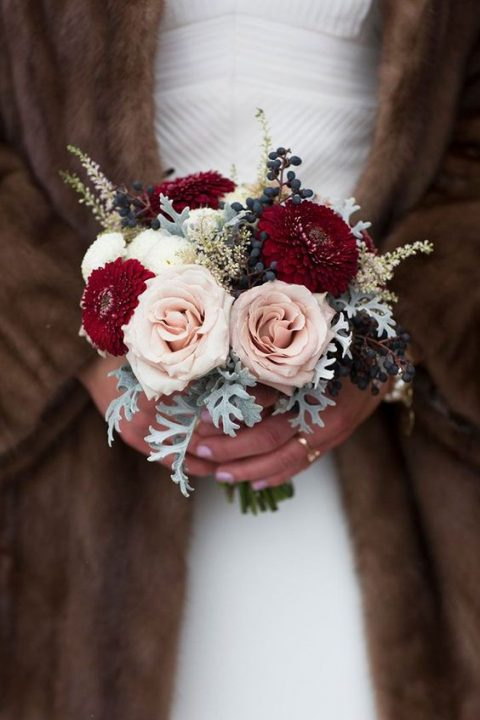 a cute small bouquet with burgundy and blush blooms_ privet berries and dusty miller