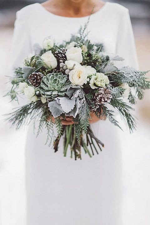 a frosty winter wedidng bouquet with succulents_ white blooms_ pinecones_ pale leaves