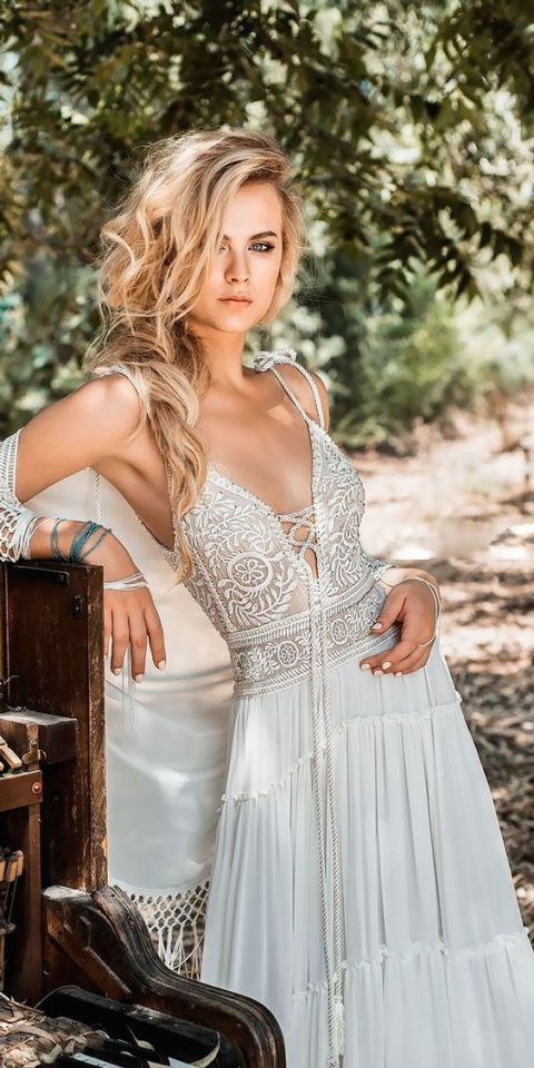 a gypsy wedding dress with a boho lace bodice on straps and a laced up plunging neckline