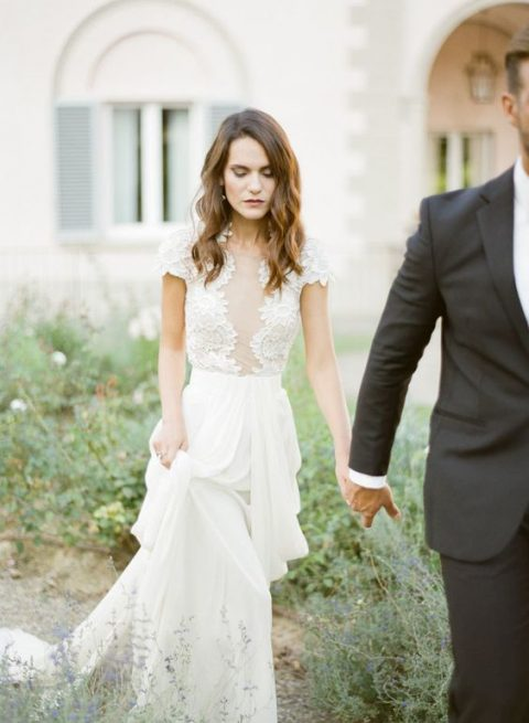 a lace cap sleeve wedding dress with a faux plunging neckline