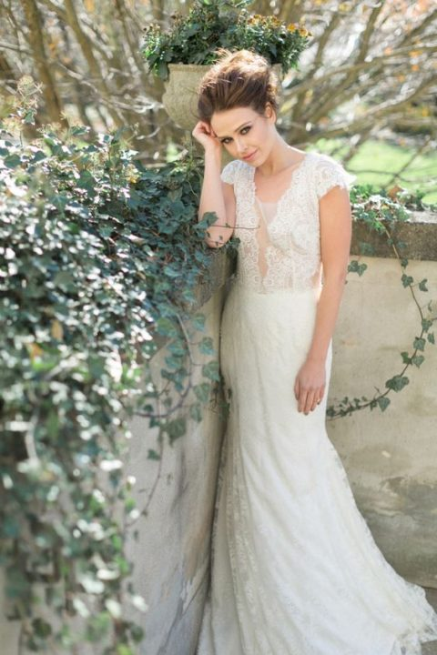 a lace wedding dress with cap sleeves and an illusion plunging neckline