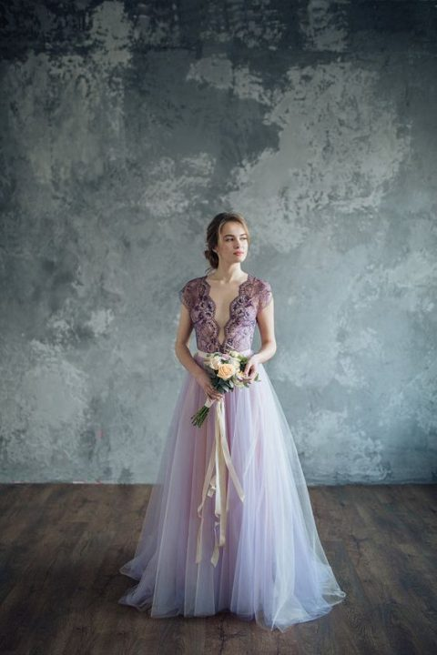 a lilac wedding dress with a lace bodice_ a plunging necklin and a layered skirt