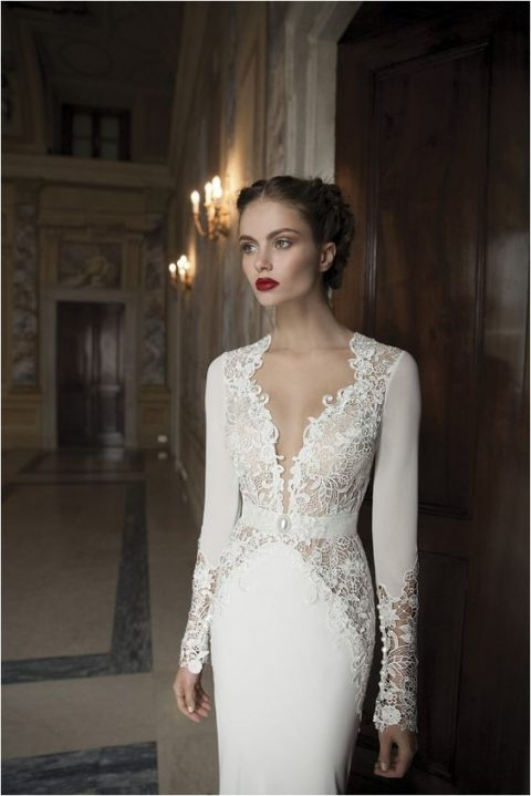 a plunging neckline wedding dress with lace inserts and long sleeves
