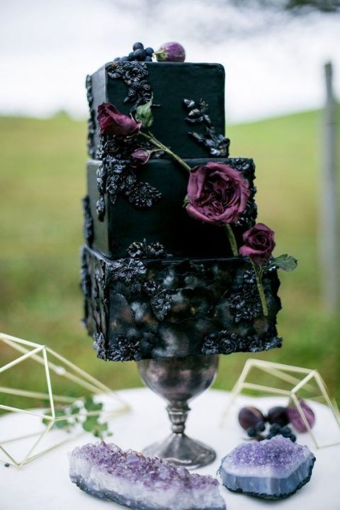a refined square moody wedding cake with unique detailing and fresh blooms