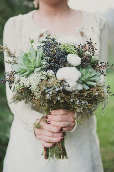 a textural bouquet with cotton_ succulents_ privet berries and textural foliage