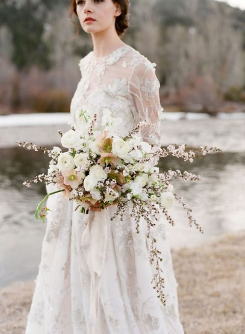 an ethereal bouquet in white and blush looks heavenly