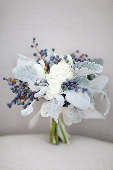 an ethereal bouquet with pale foliage_ privet berries and white blooms