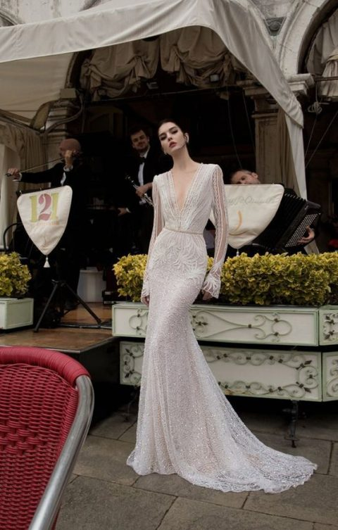 glam Old Hollywood wedding dress with beading and a plunging neckline