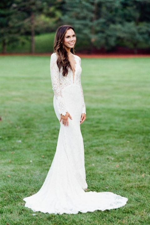 mermaid lace wedding dress with a plunging neckline and long sleeves